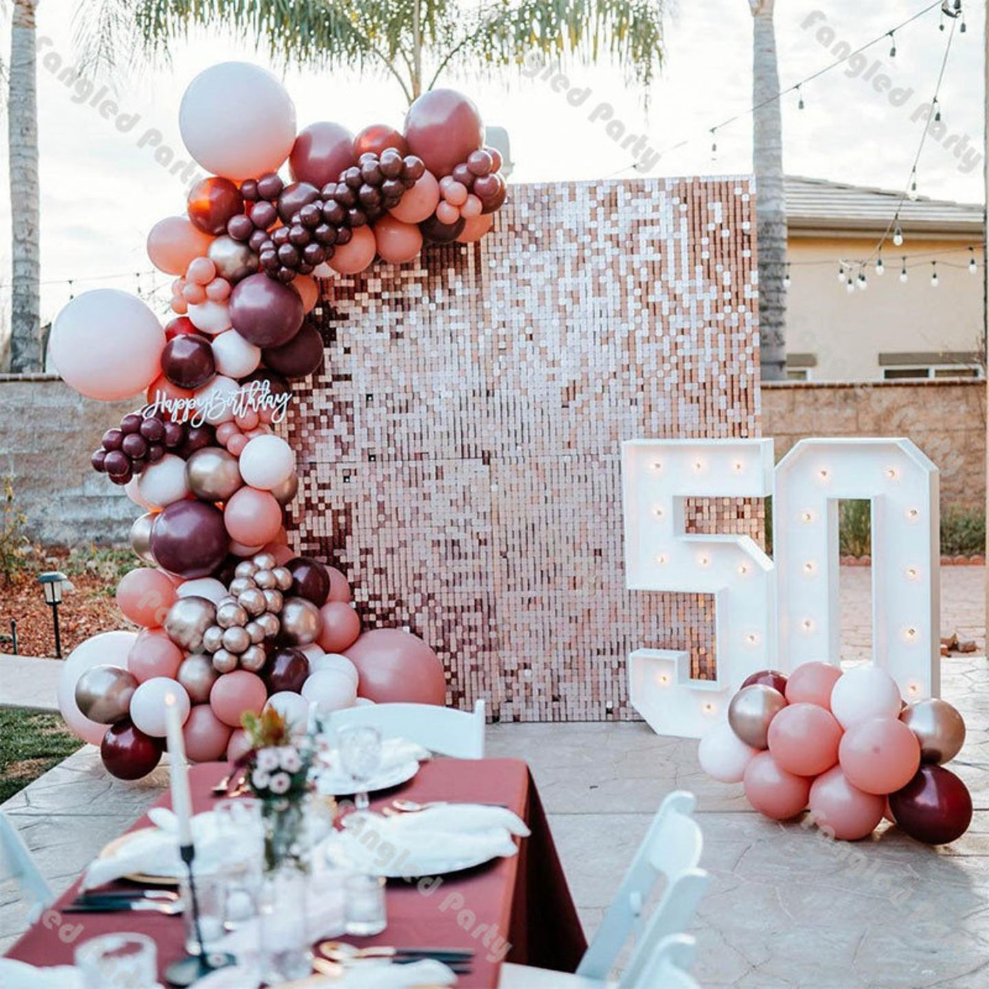 Pink, mauve and rose gold balloons and birthday party decor with custom sign
