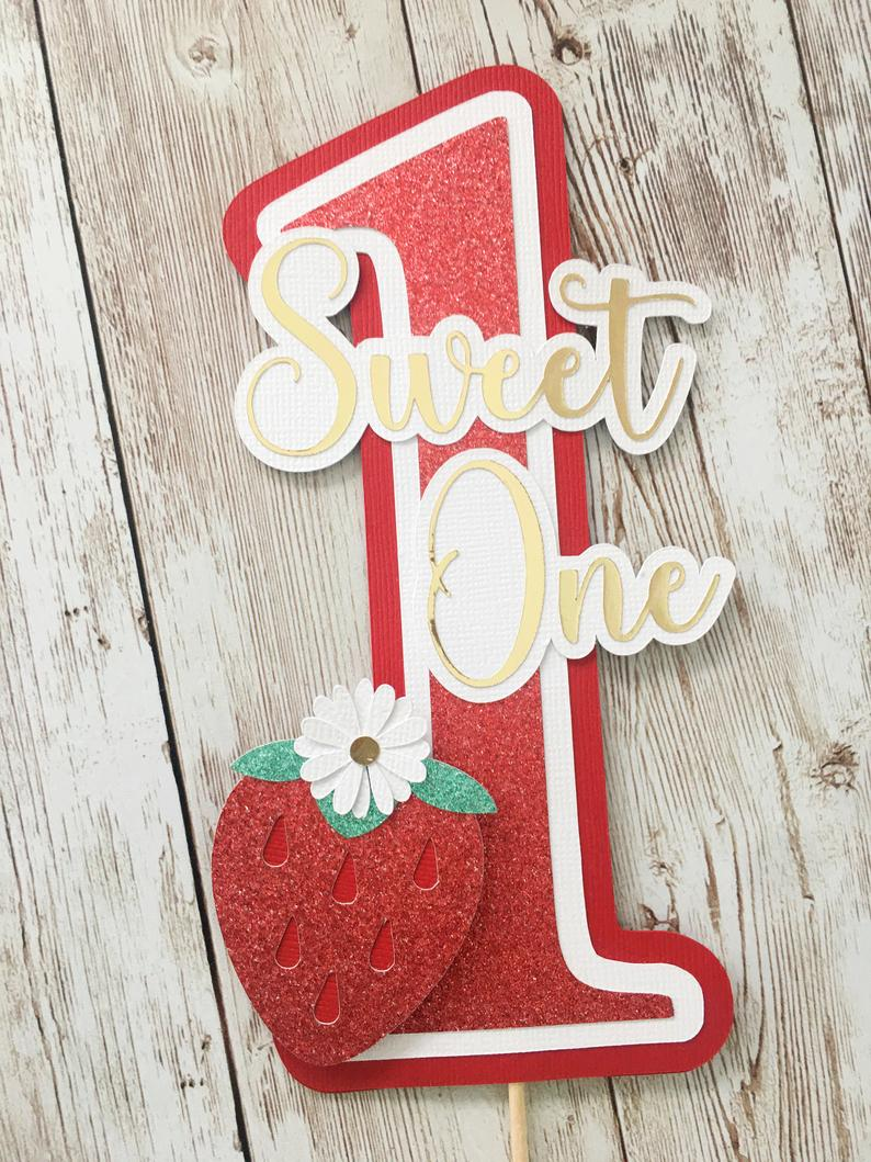 Cake topping decor with strawberry design