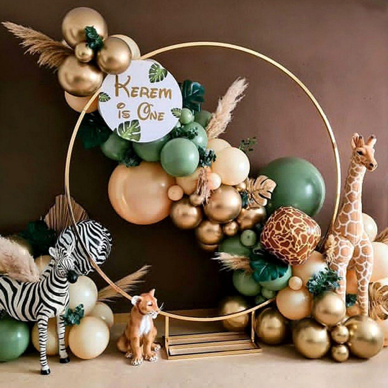 Green and gold safari themed balloon garland arch
