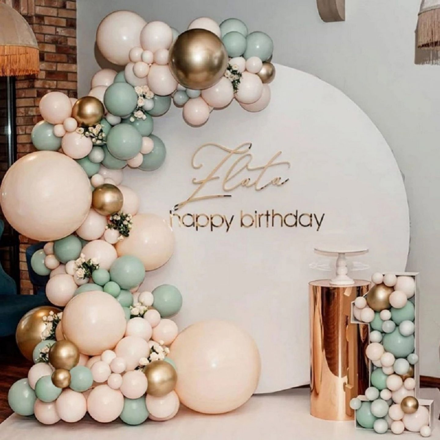 Cream and sage green birthday party balloons with gold details
