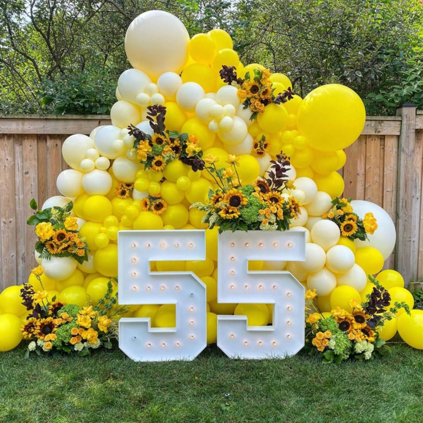 Fancy yellow balloons and birthday sign with numbers