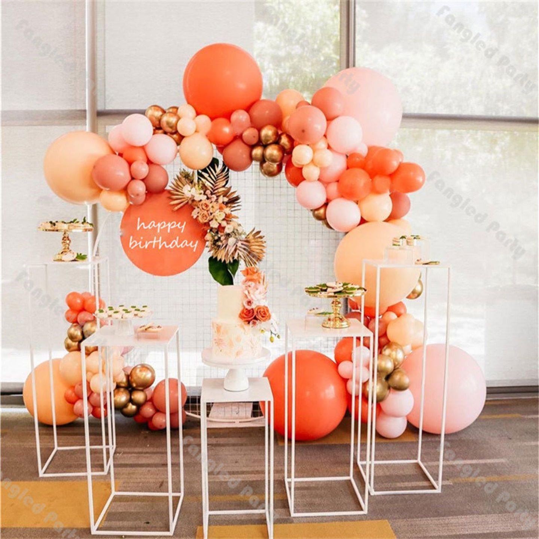 Peach colored balloon garland arch