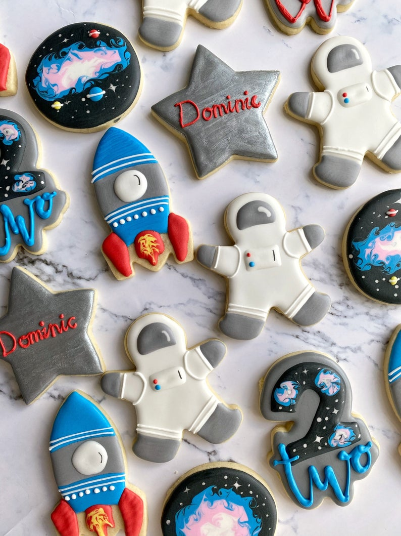 Decorated sugar cookies with astronauts and space theme