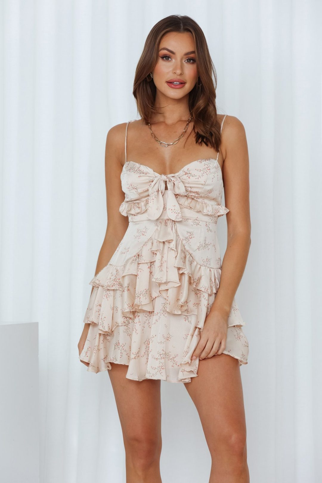 Light pink floral mini dress with ruffles