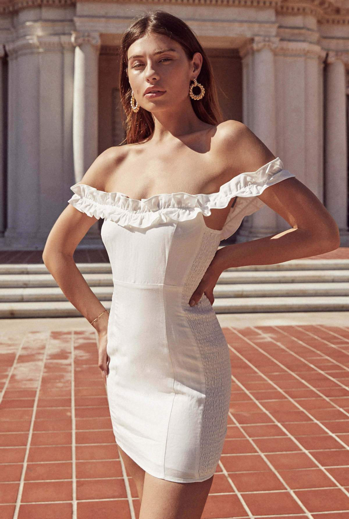 White mini dress with ruffle details