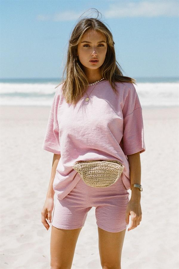 Pink biker shorts outfit with matching oversized t-shirt and shorts