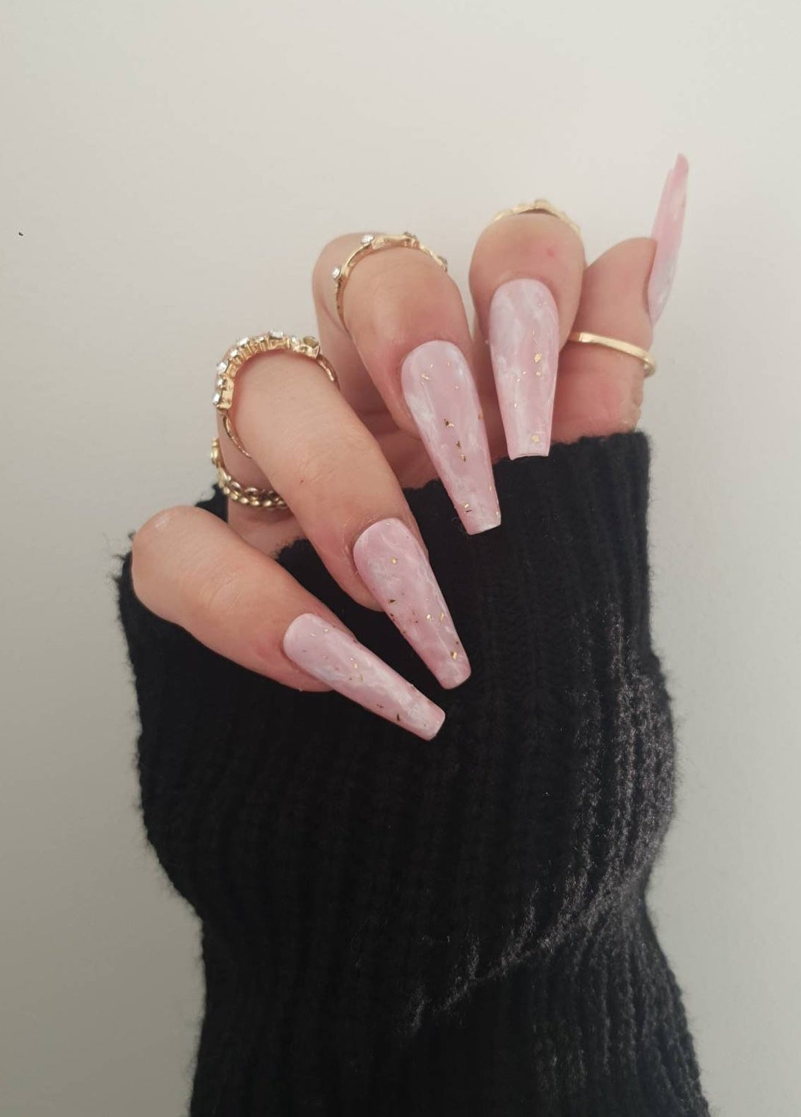 Long light pink marble nails with gold flecks