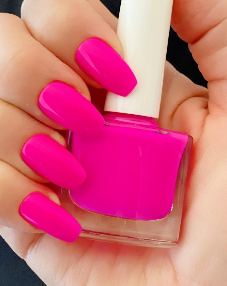 Fuchsia nail polish on short nails