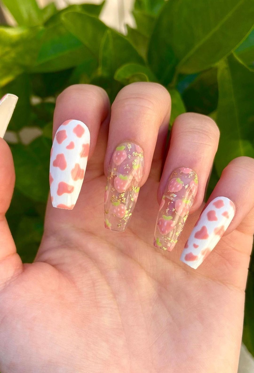 White and light pink cow and strawberry nails