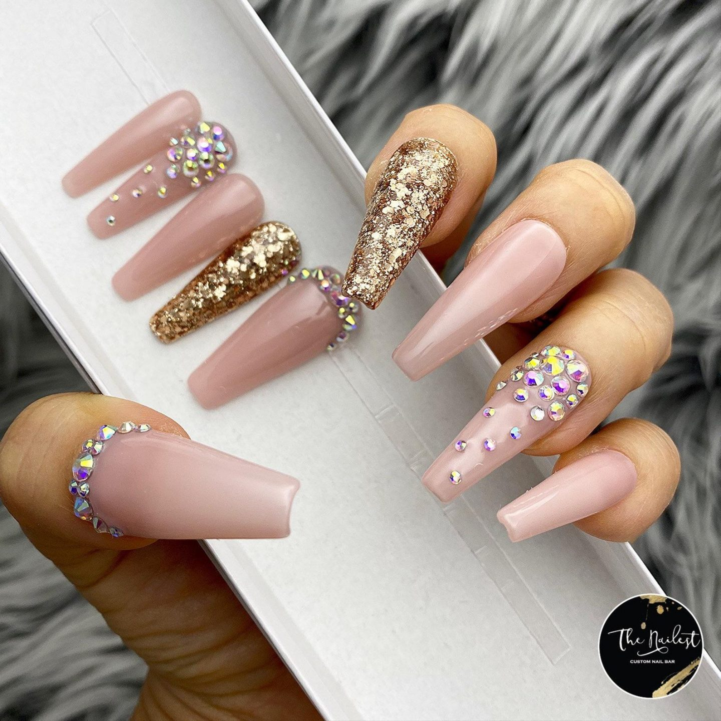 Long nude coffin nails with rhinestones and gold flakes