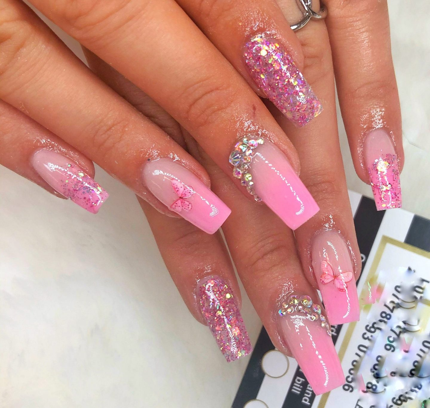 Pink ombre nails with glitter and rhinestones