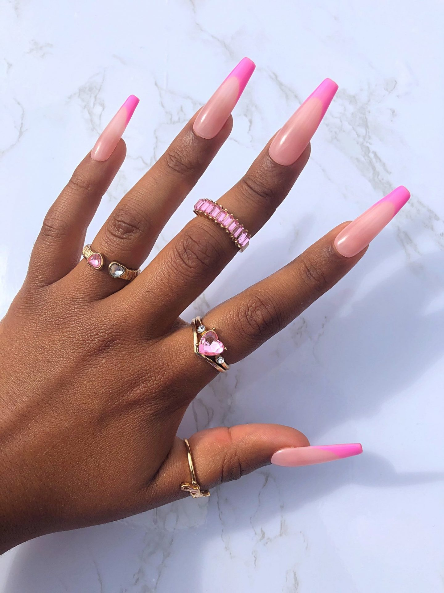 Long pink French tip nails