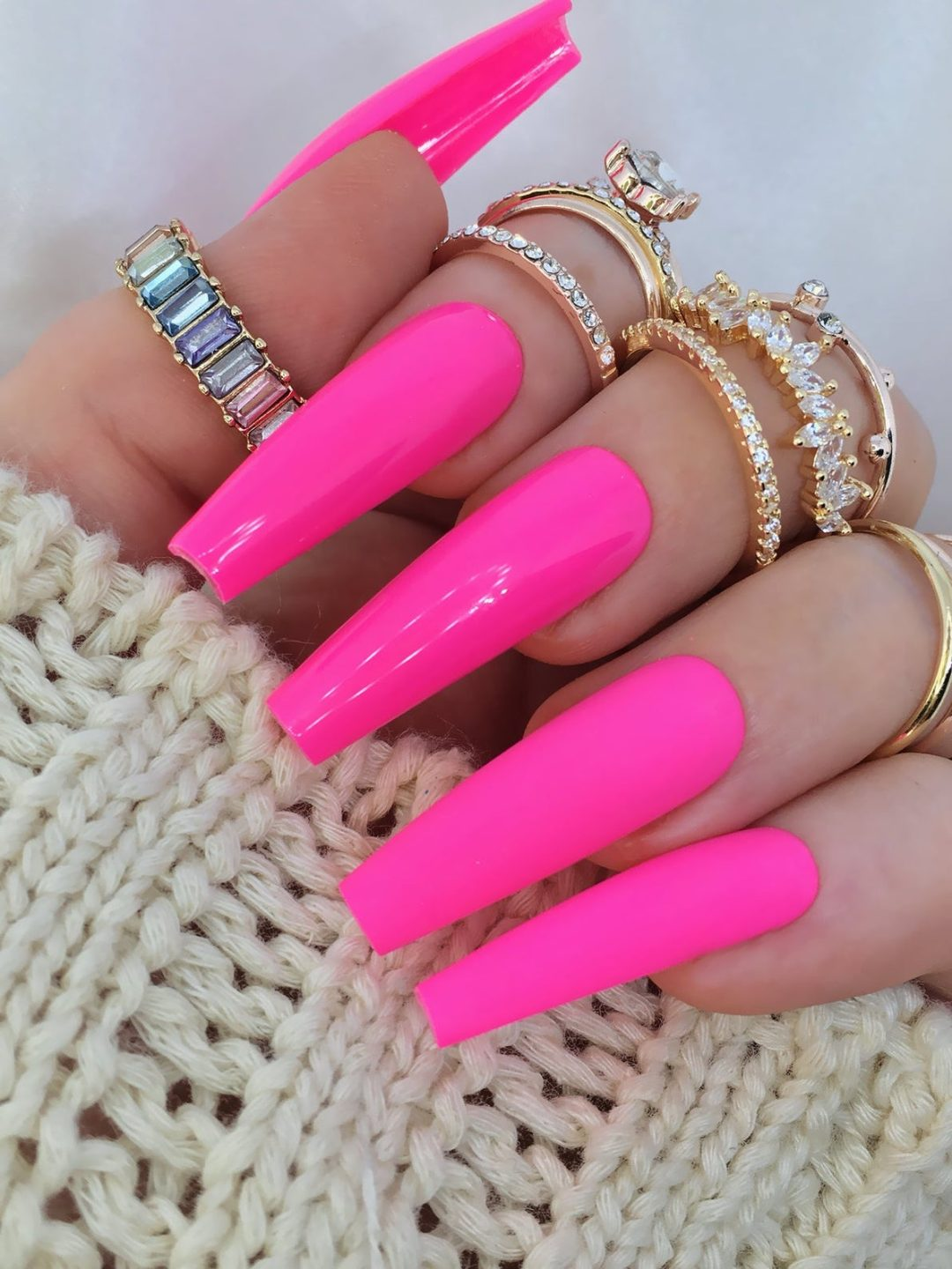 Hot fuchsia pink nails in acrylic coffin shape