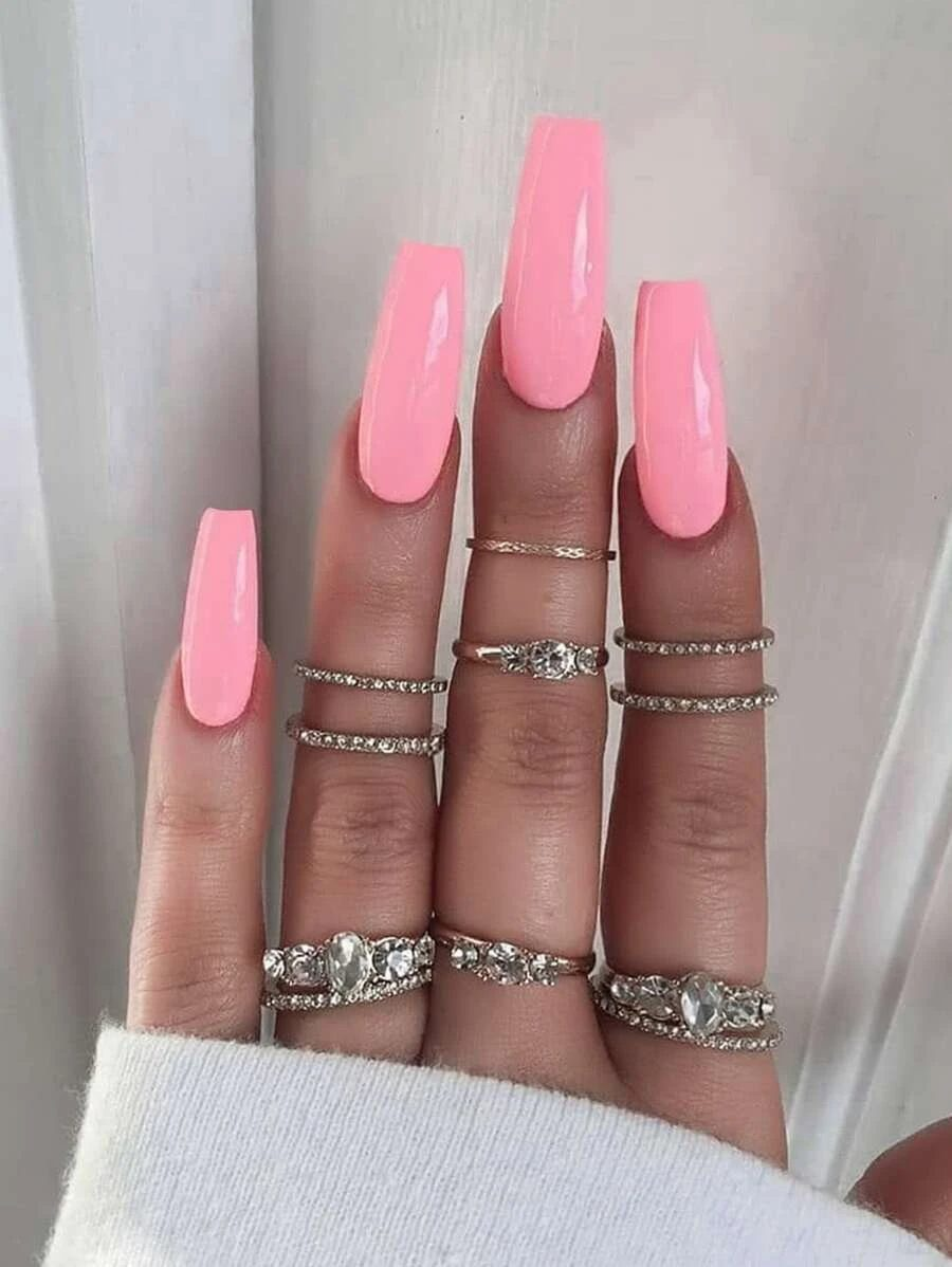 Hot pink acrylic coffin nails with silver midi rings