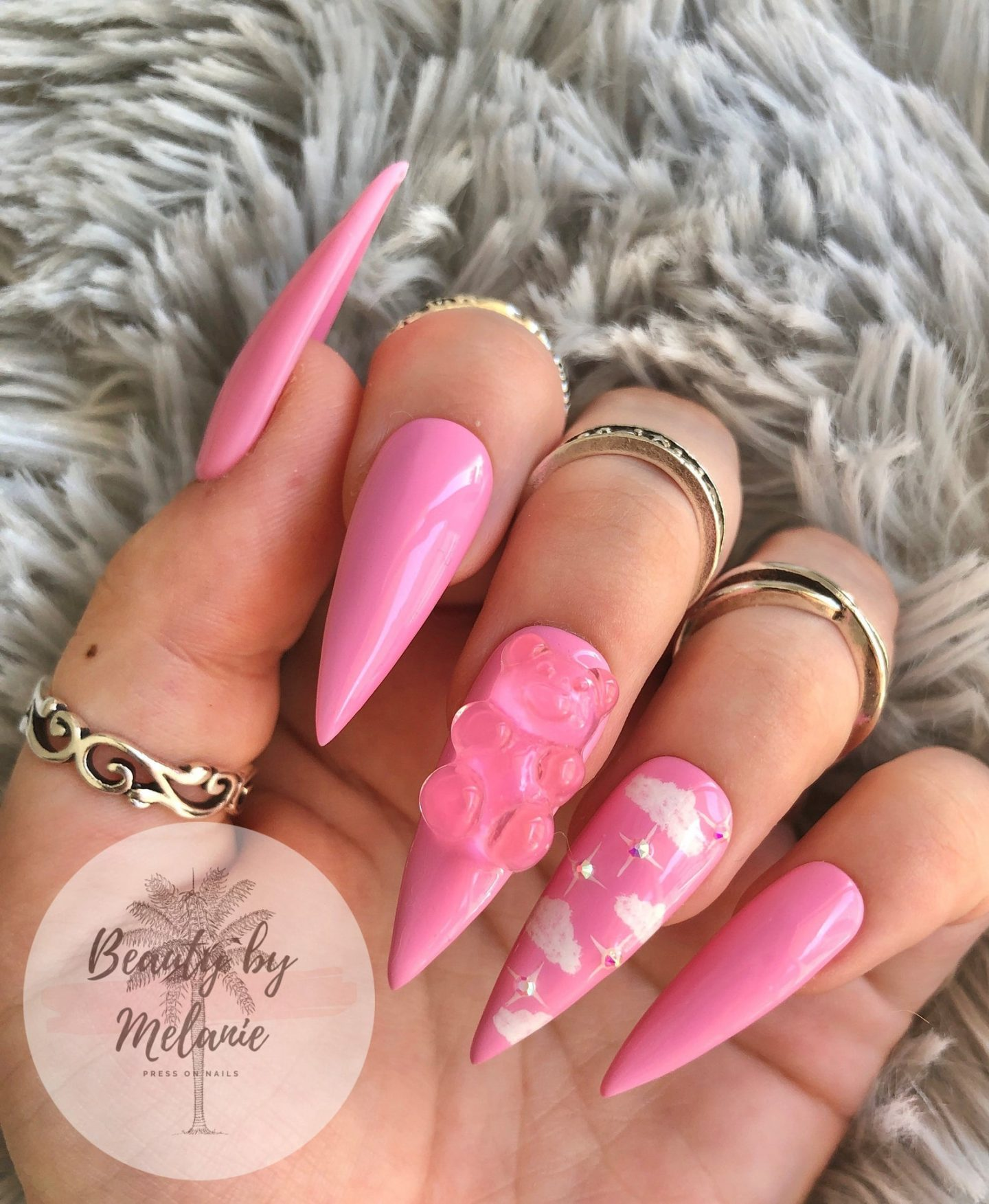 Pink gummy bear nails in acrylic stiletto shape