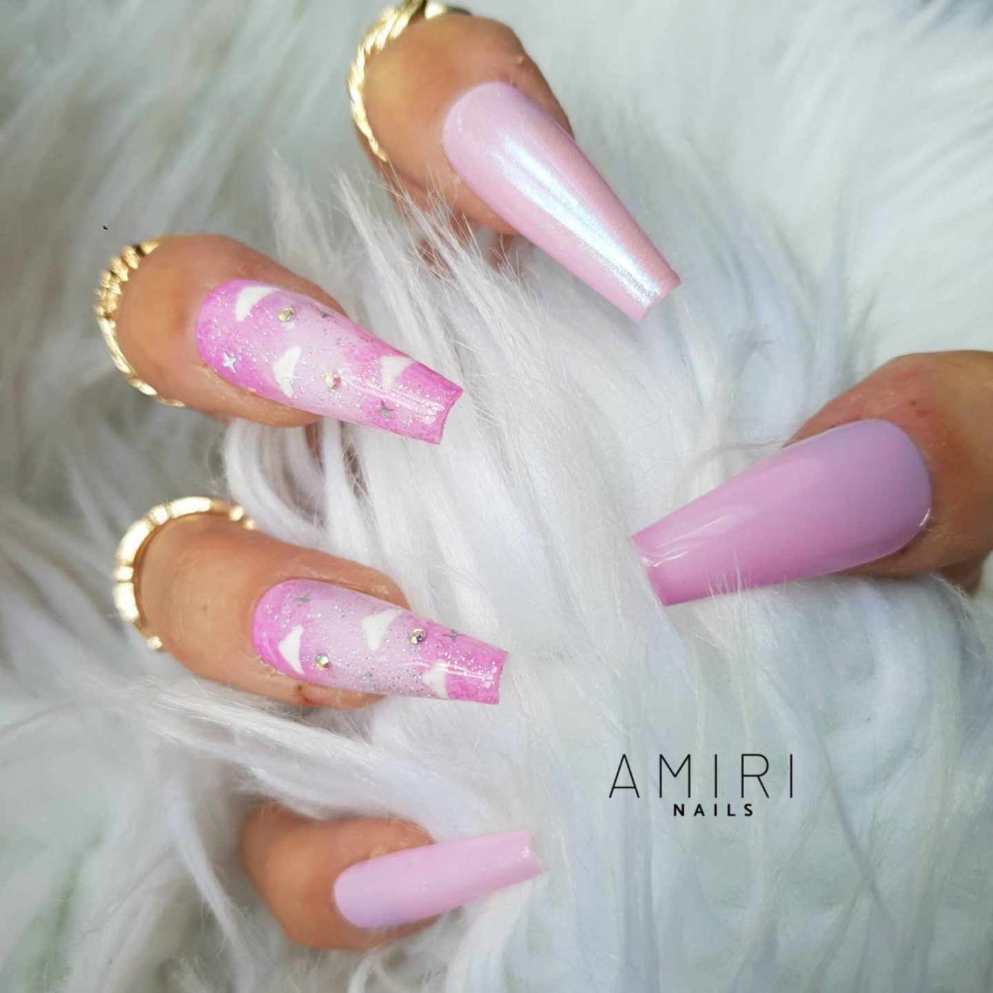 Pink holographic unicorn nails with cloud nail art
