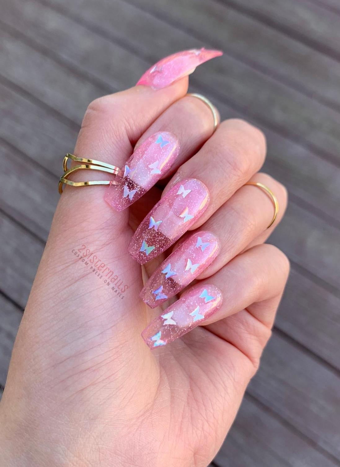 Pink transparent nails with butterfly nail art