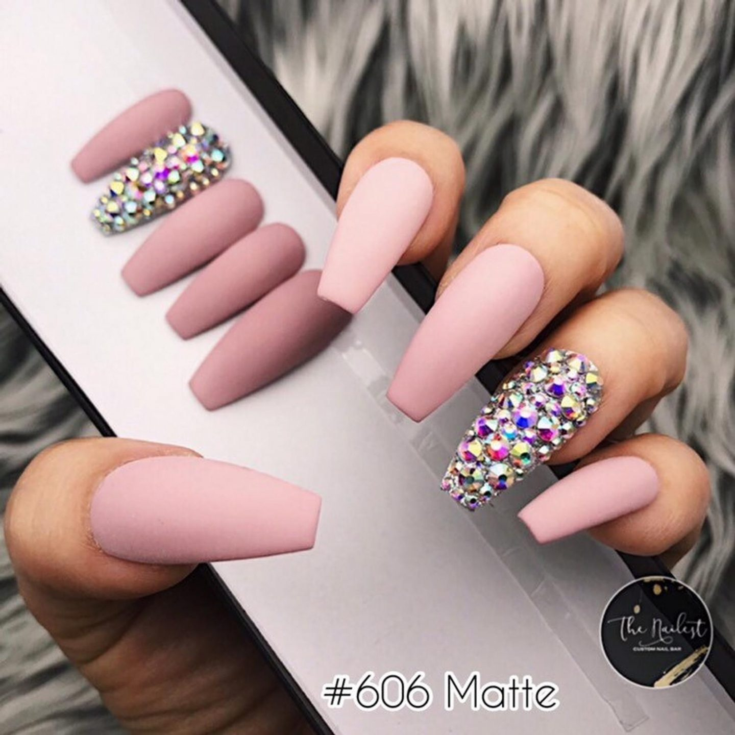 Matte pink nails with rhinestones