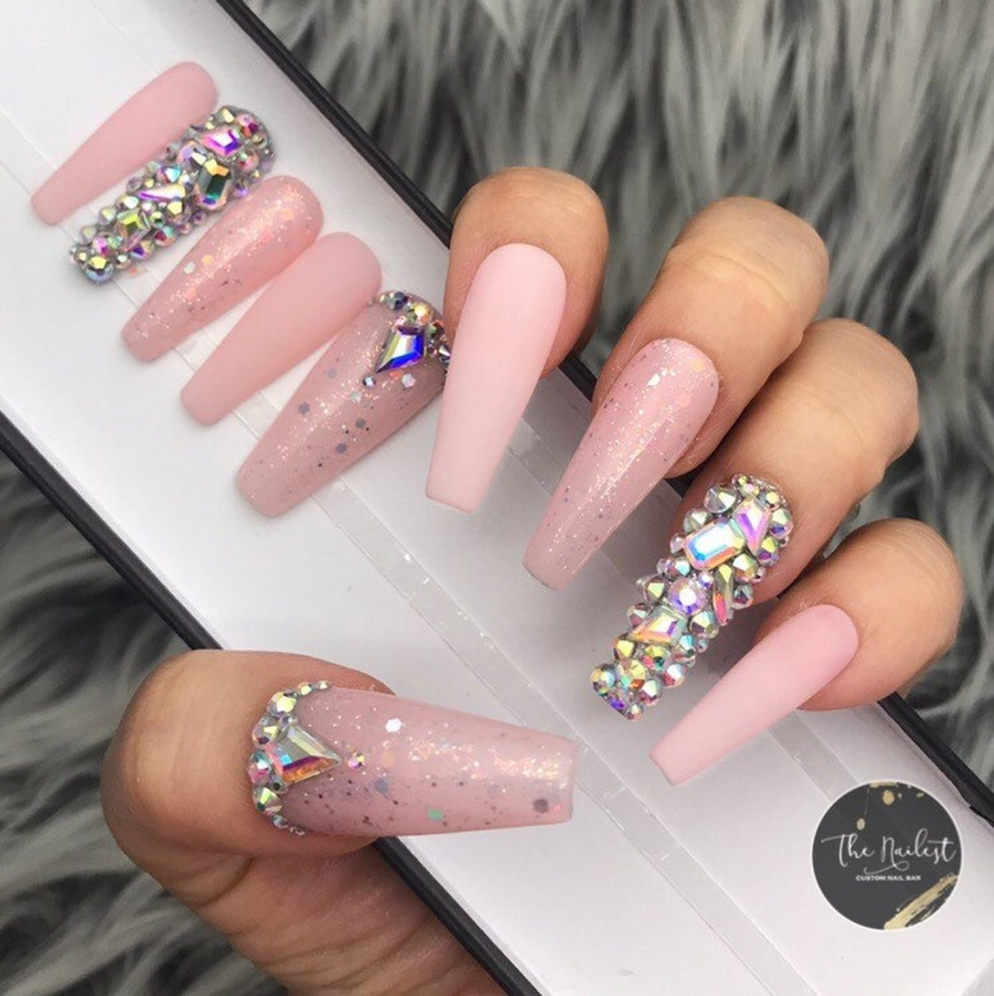 Long light pink coffin nails with rhinestones
