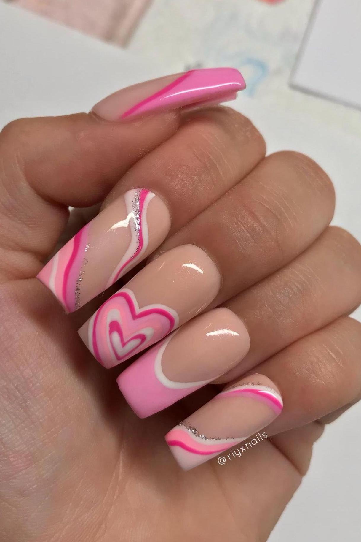 90s inspired pink heart nails with swirls