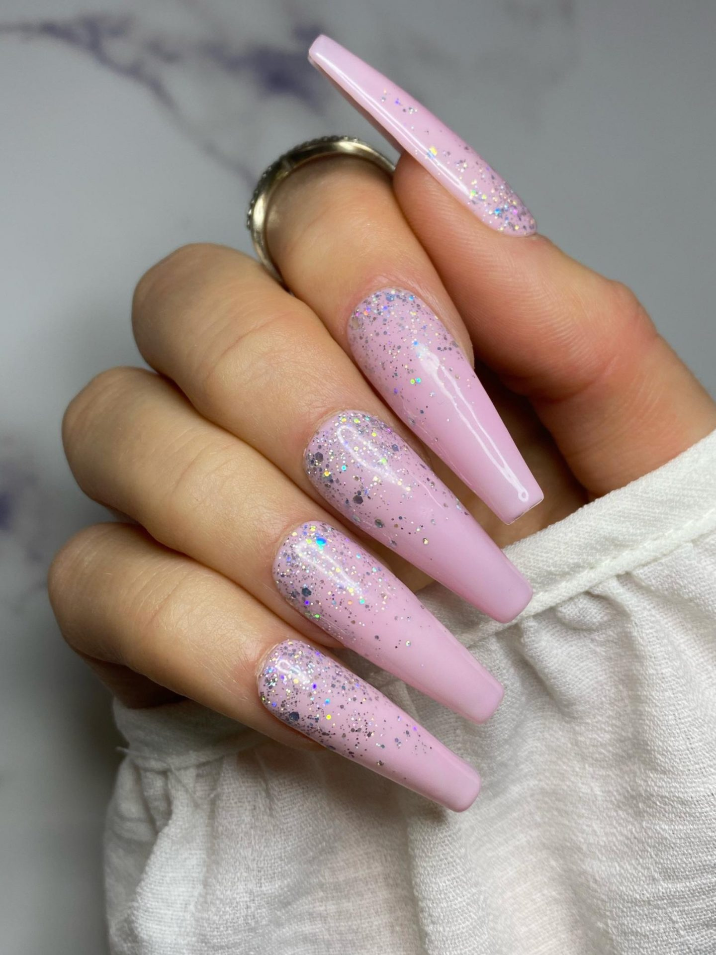 Long light pink nails with glitter