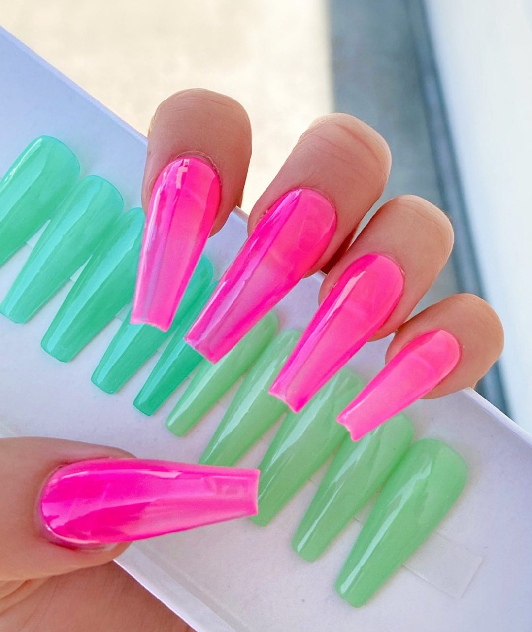 Long hot pink jelly nails in coffin shape