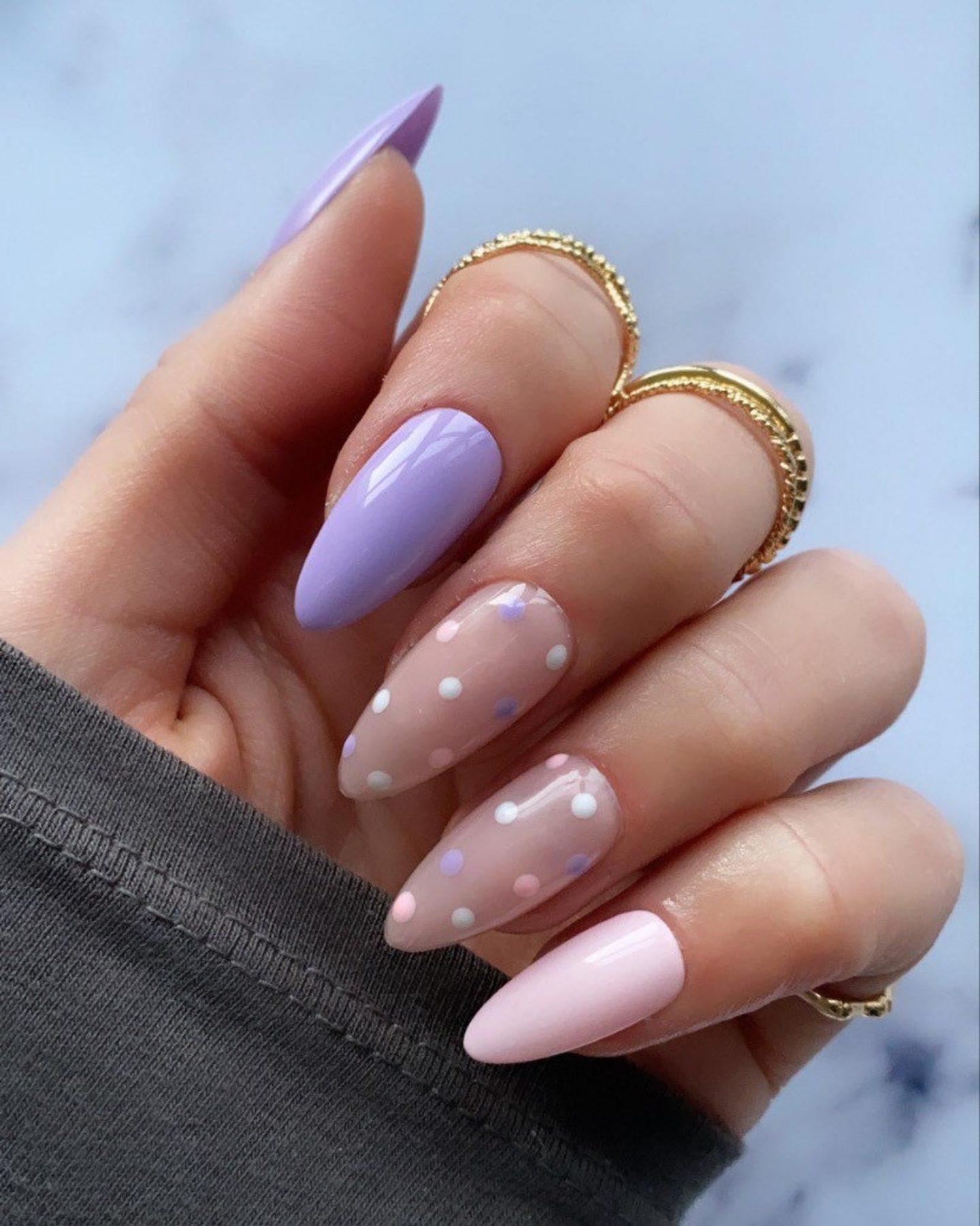 Pink and purple nails with polka dots