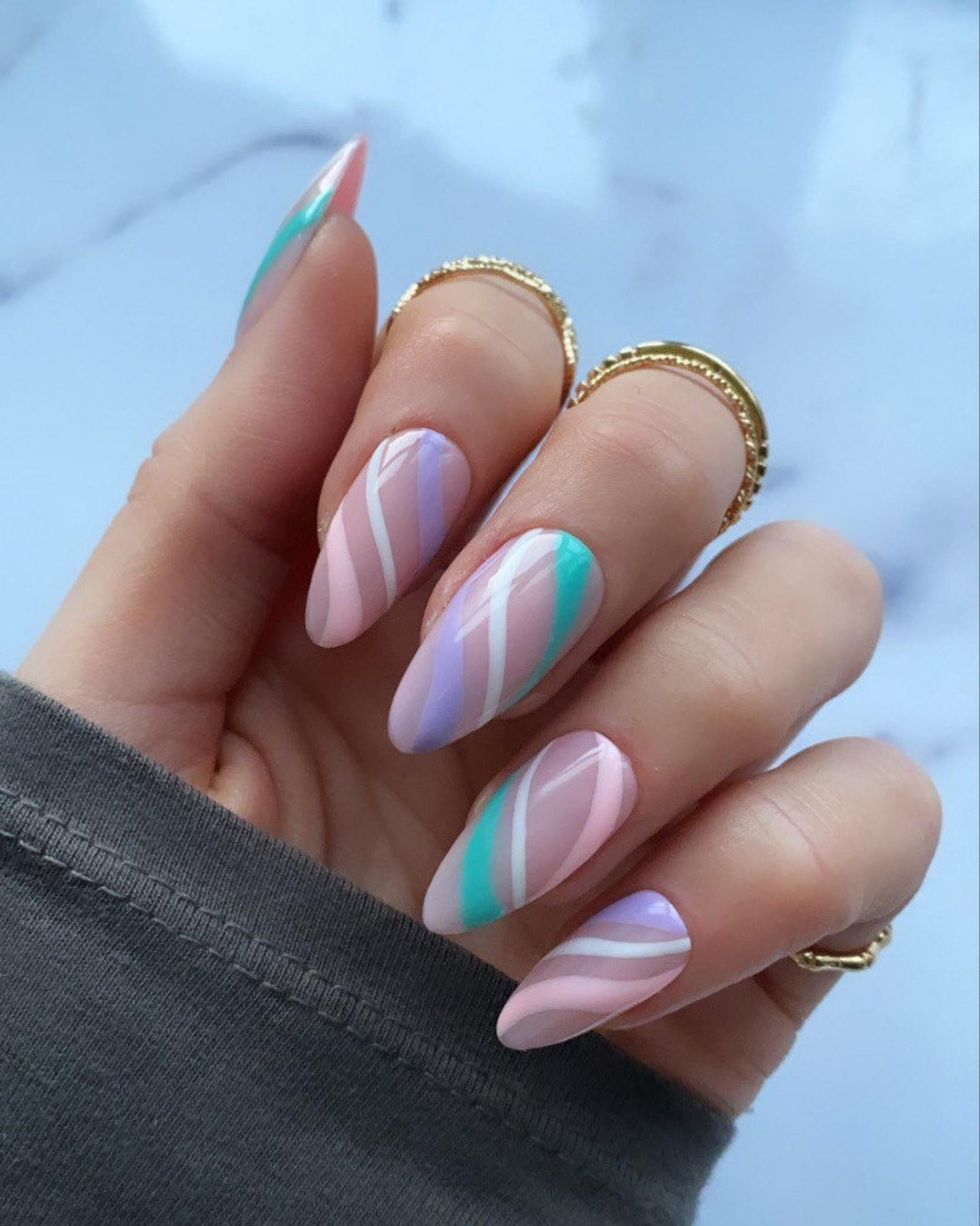 Cute pastel abstract nails with swirls