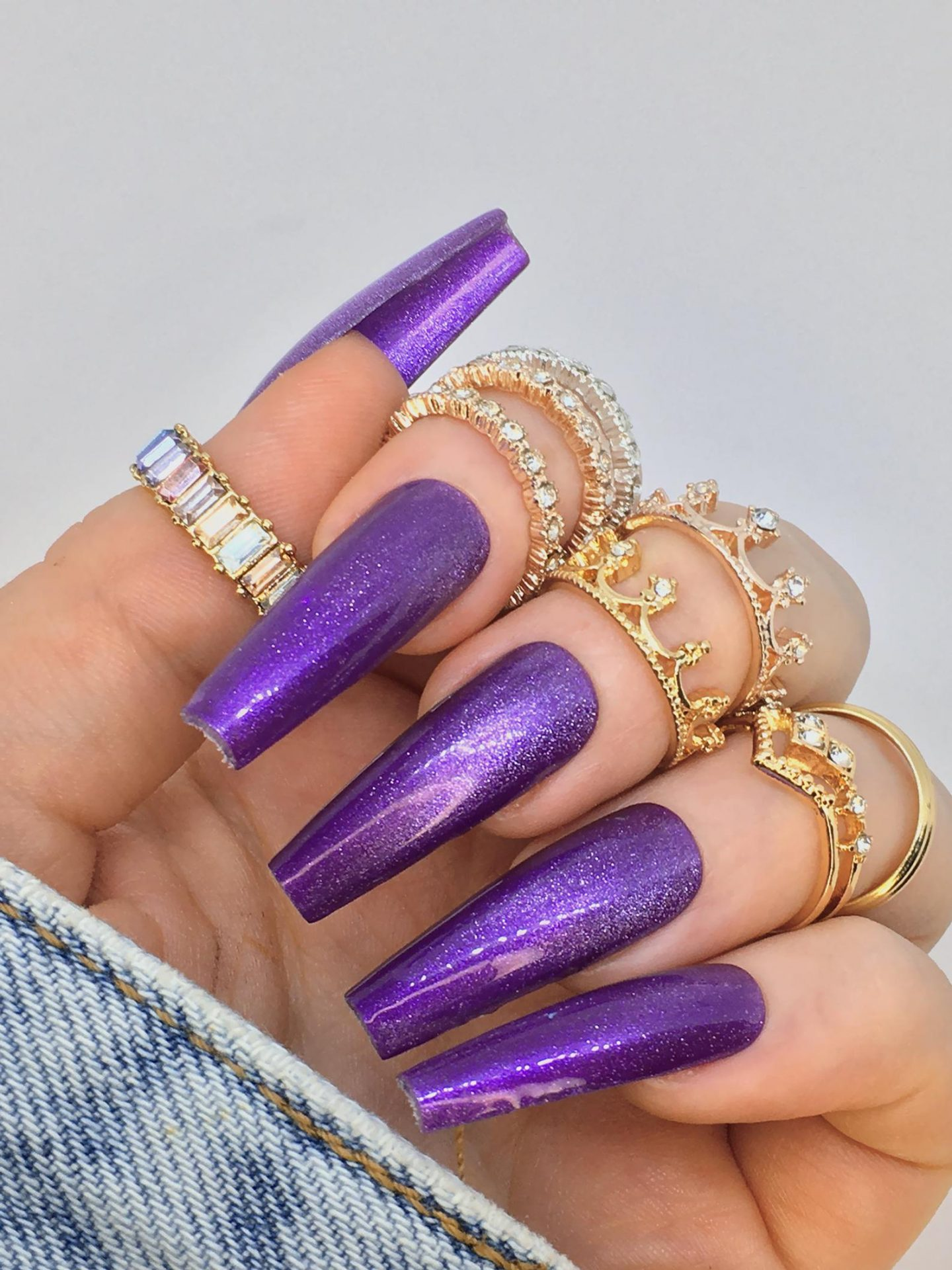Long glossy purple nails with glitter