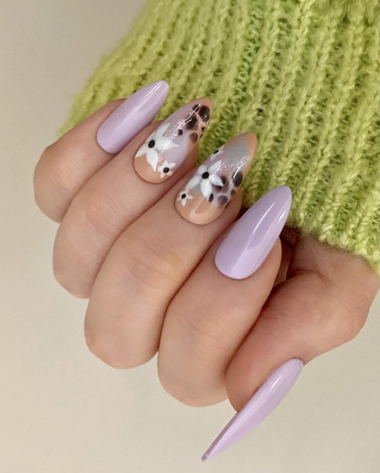 Pastel lavender nails with flower nail art