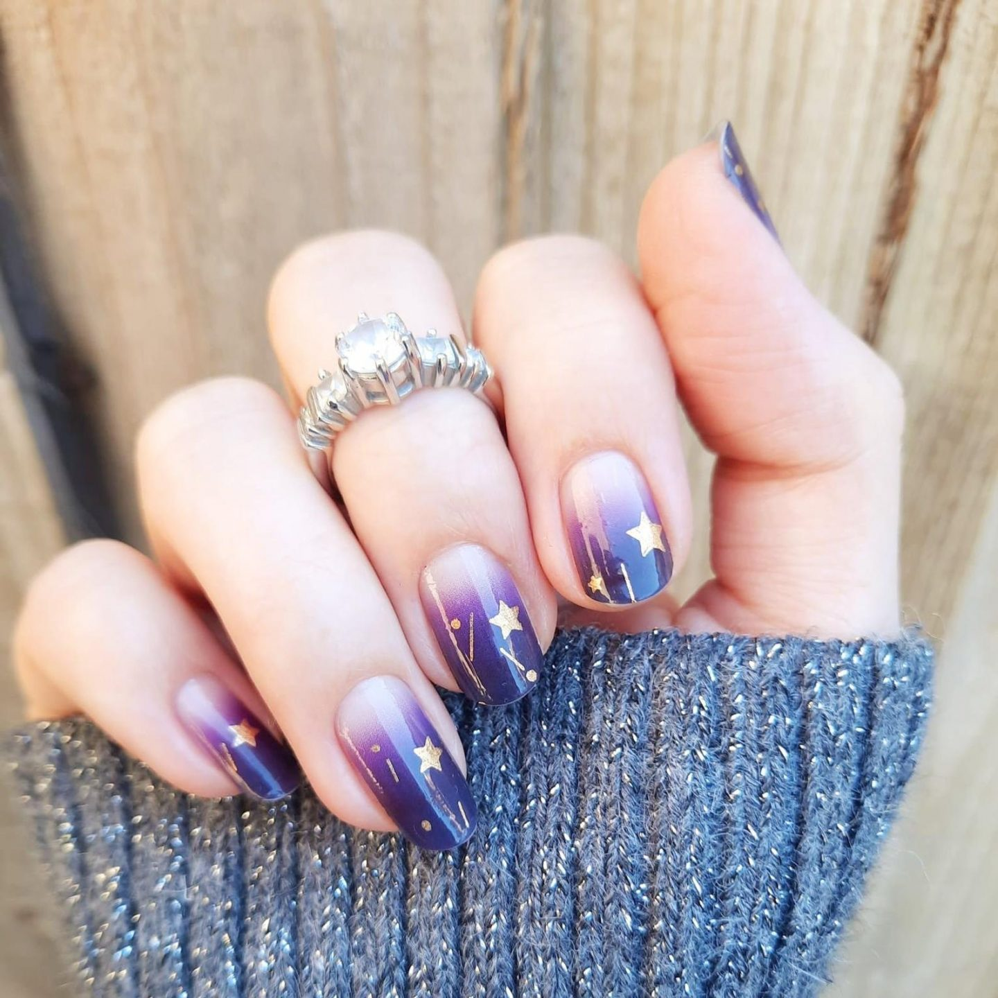 Short dark purple ombre nails with stars