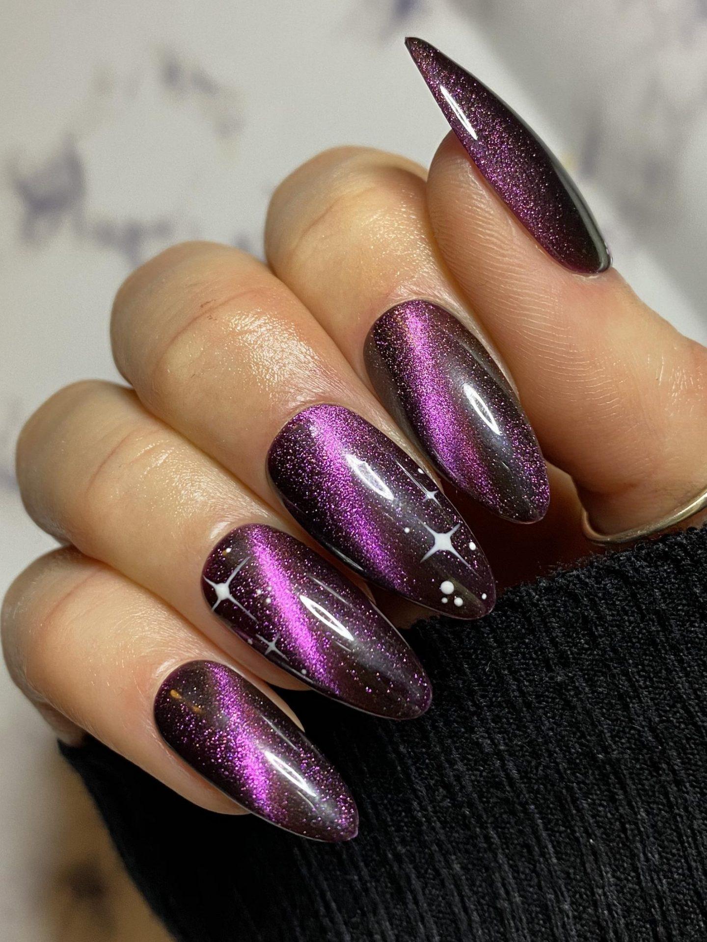 Black and purple glitter nail designs