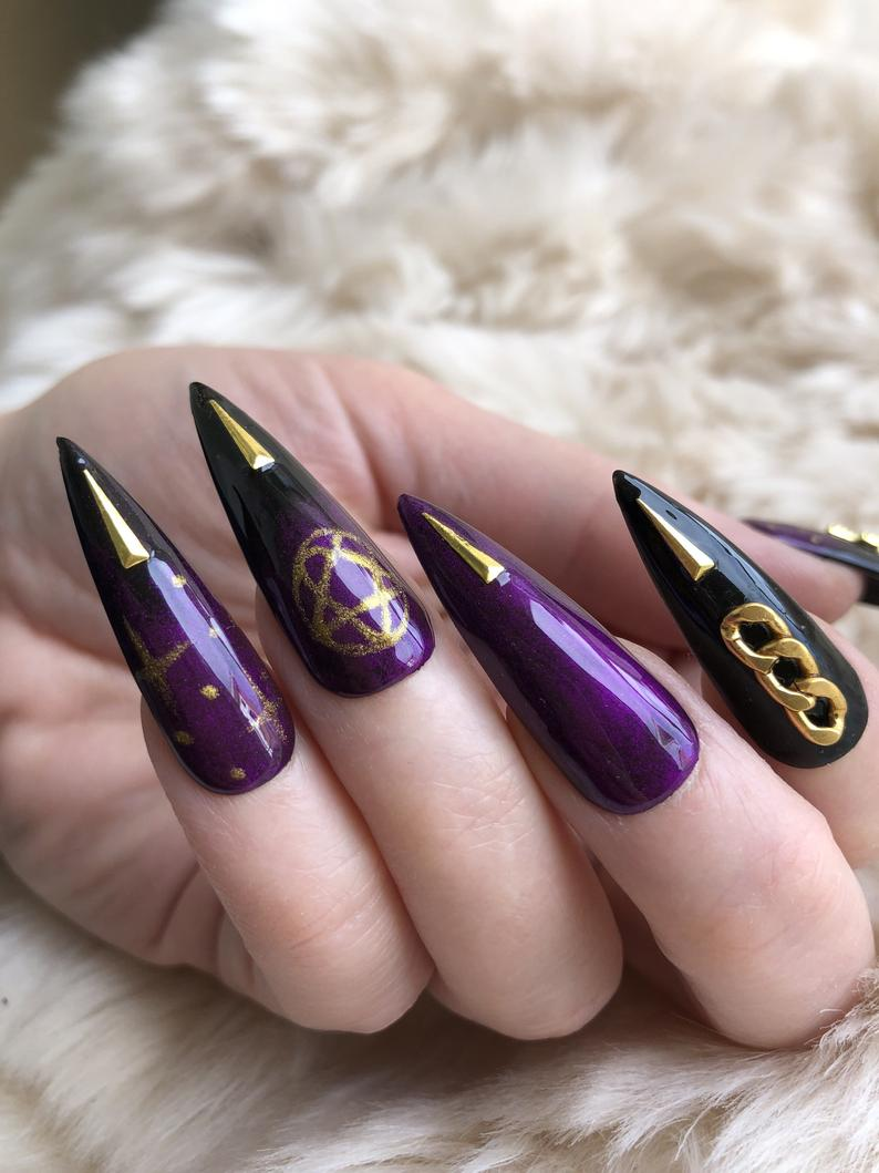 Black and purple Halloween nails with gold nail art
