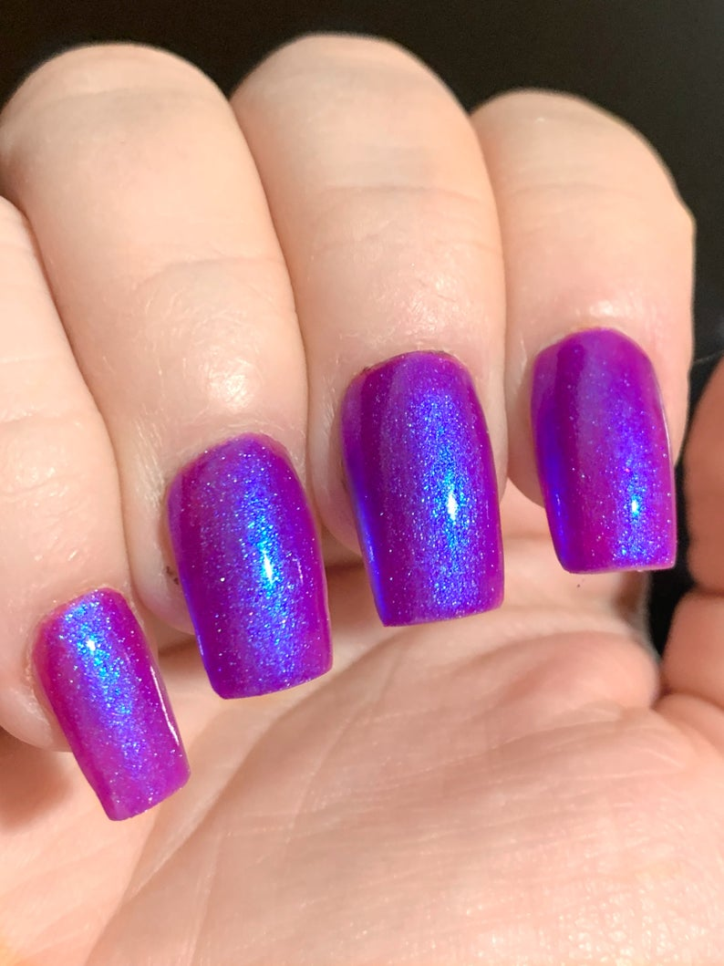 Short purple holographic nails with glitter