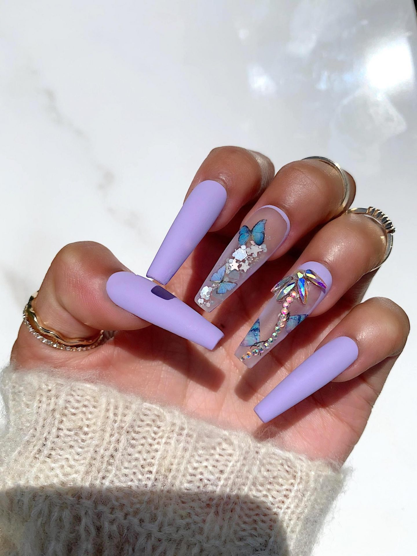 Light purple long coffin nails with blue butterfly nail art