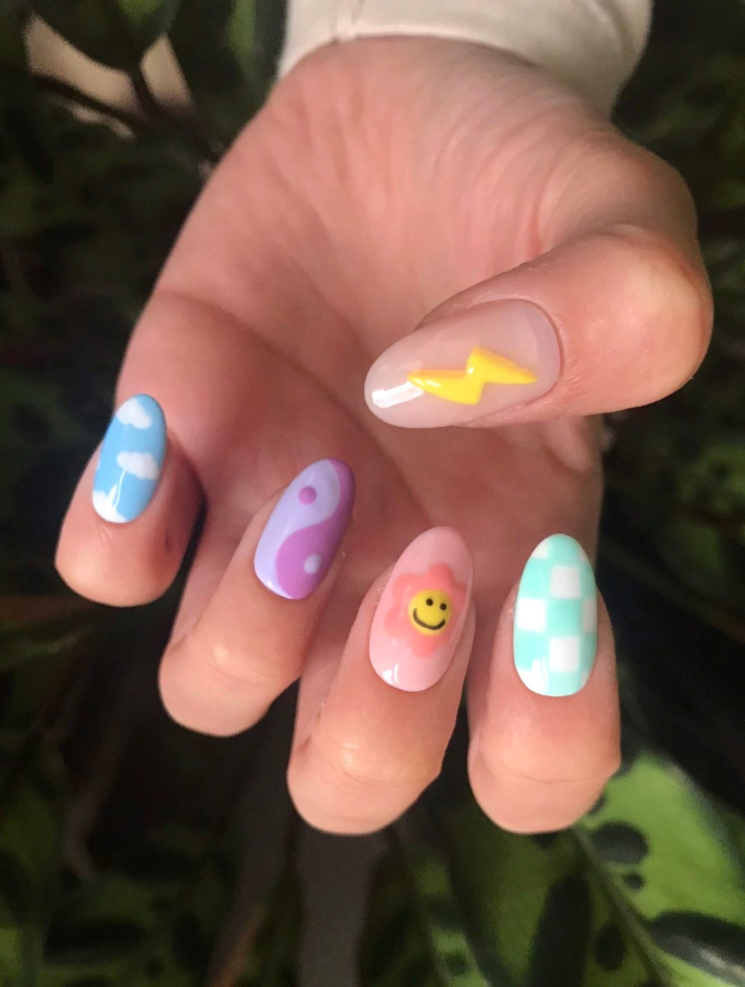 Pastel mix and match nails with emojis
