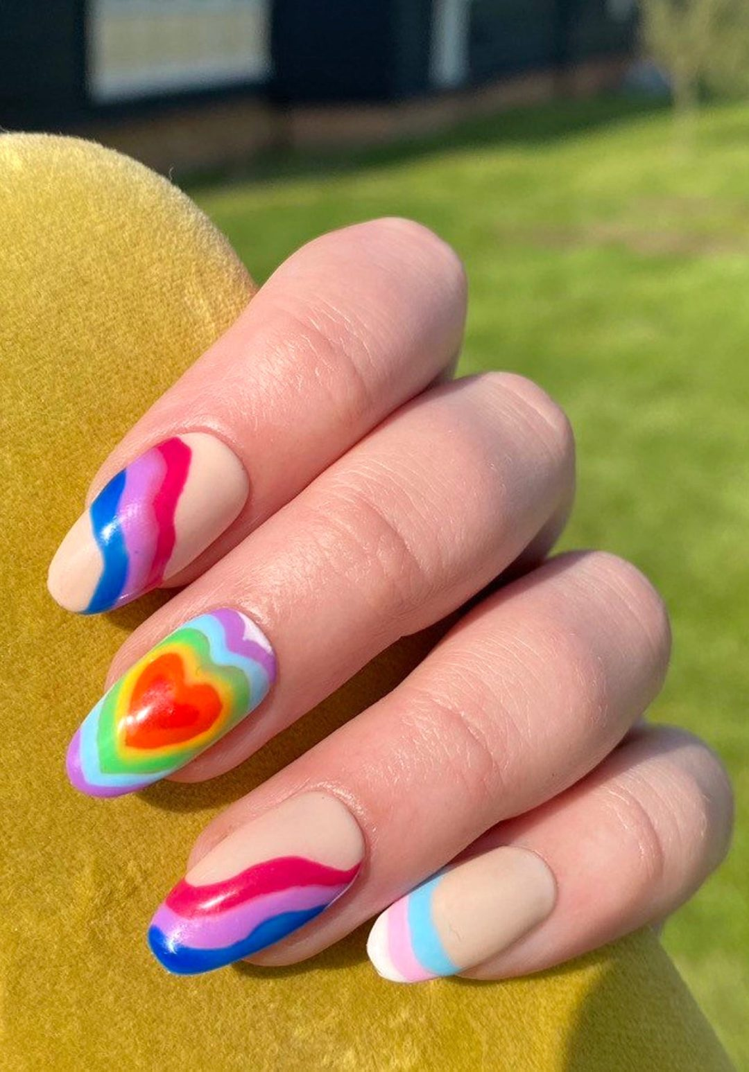 Mix and match abstract rainbow heart nails with swirls