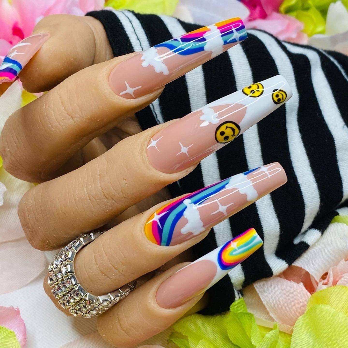 Rainbow nails with smile emojis in long acrylic coffin shape