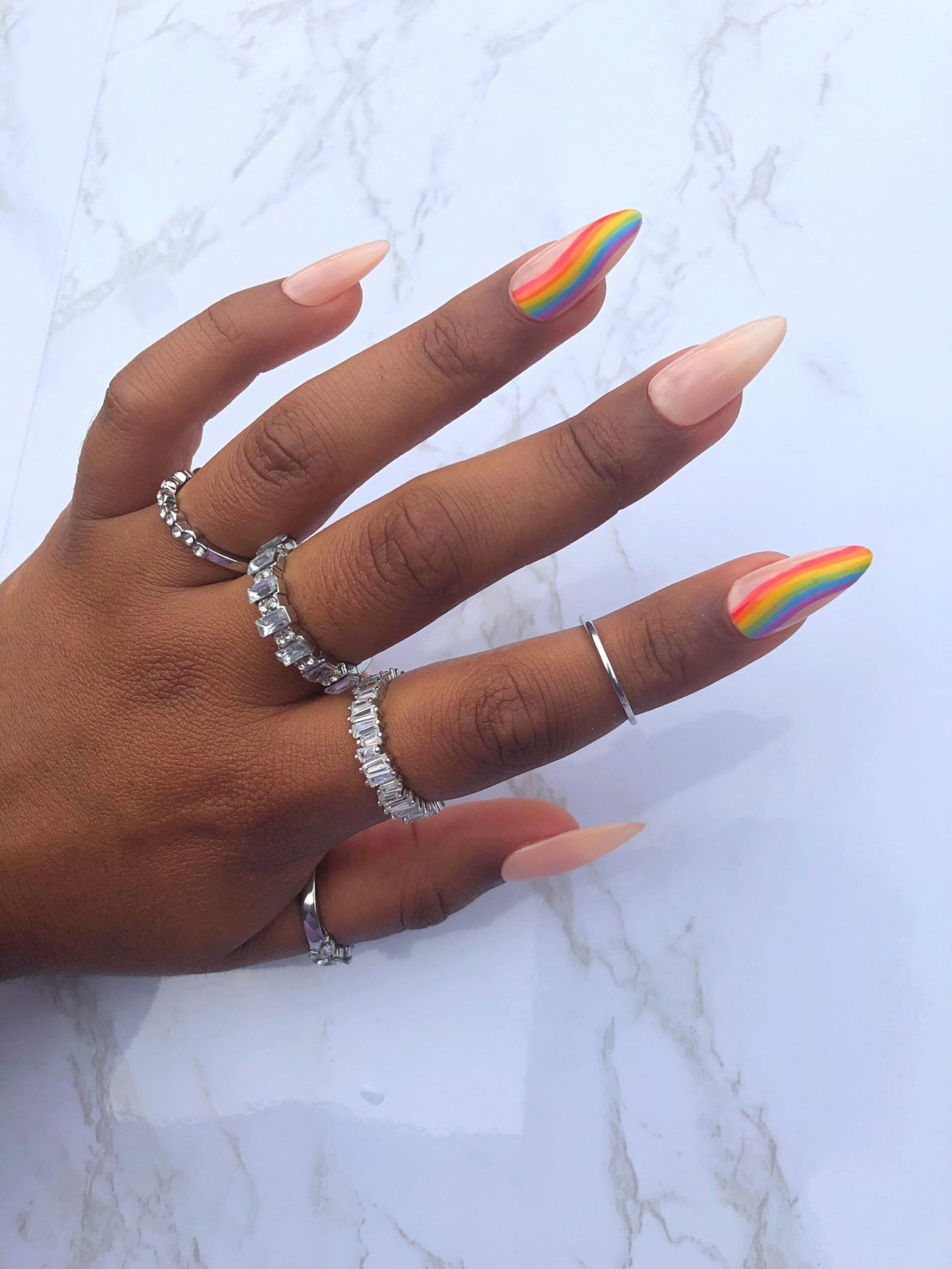 Nude almond nails with rainbow flags