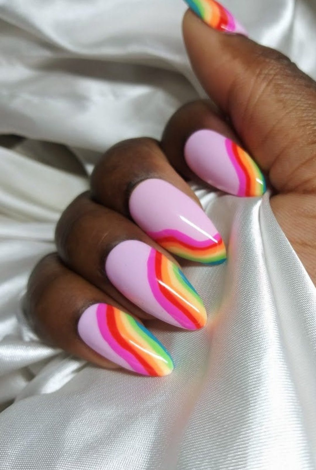 Pink almond nails with rainbow nail art