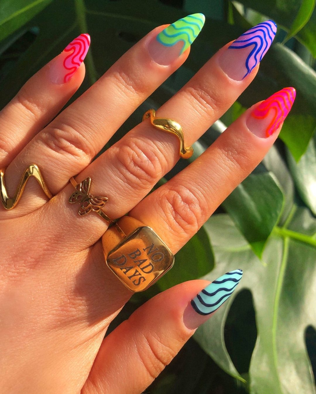 Colorful abstract swirl French tip nails