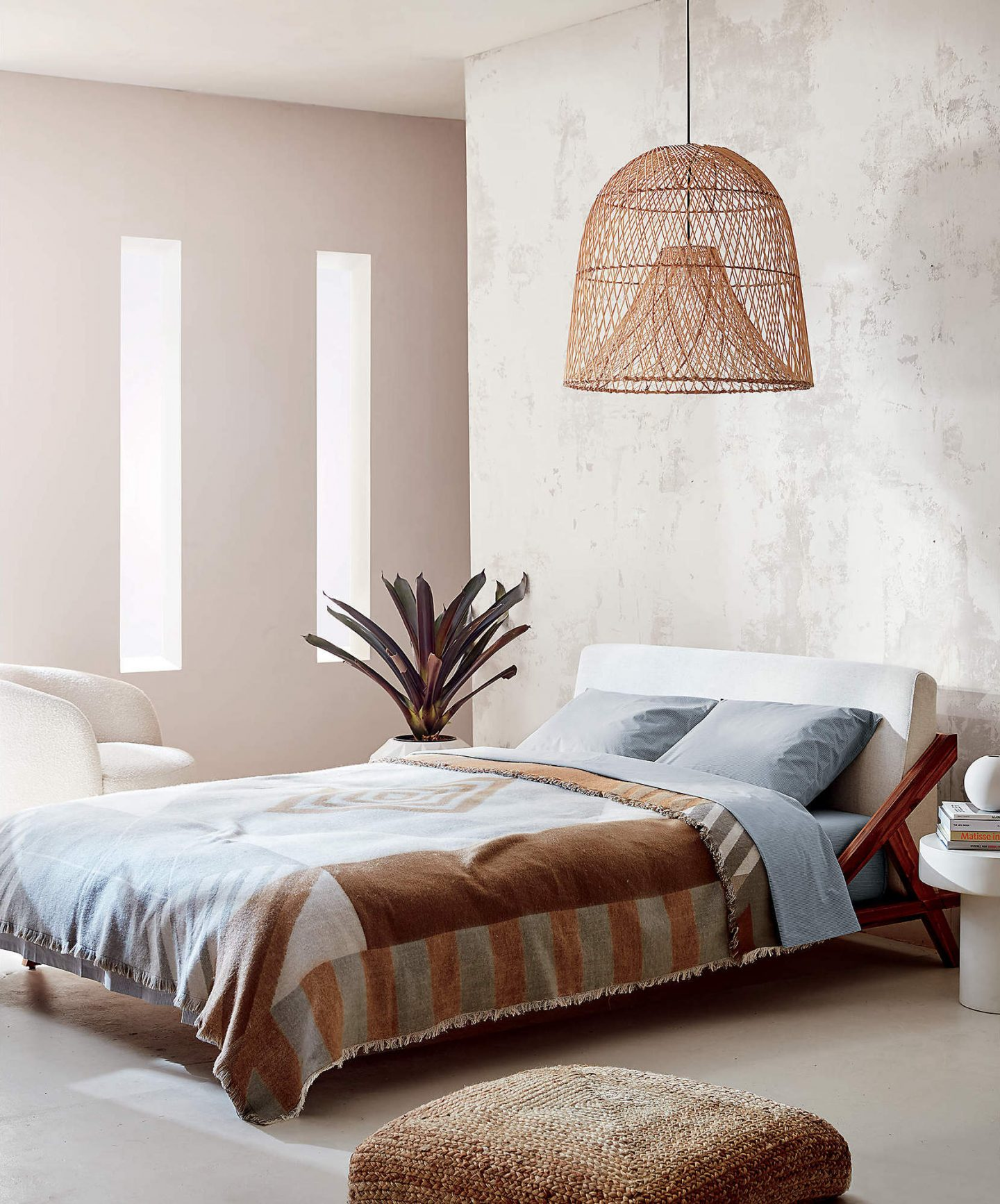 Rattan pendant light and low bed