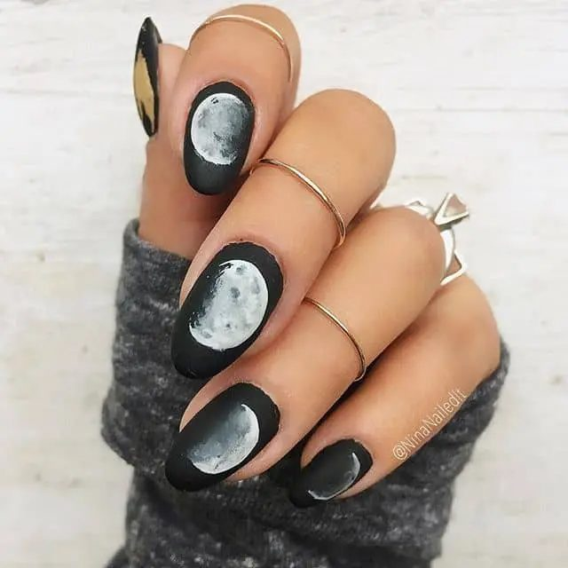 Matte black nails with white moon design