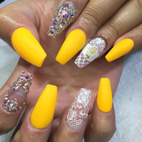 Yellow nails with rhinestones and lace design