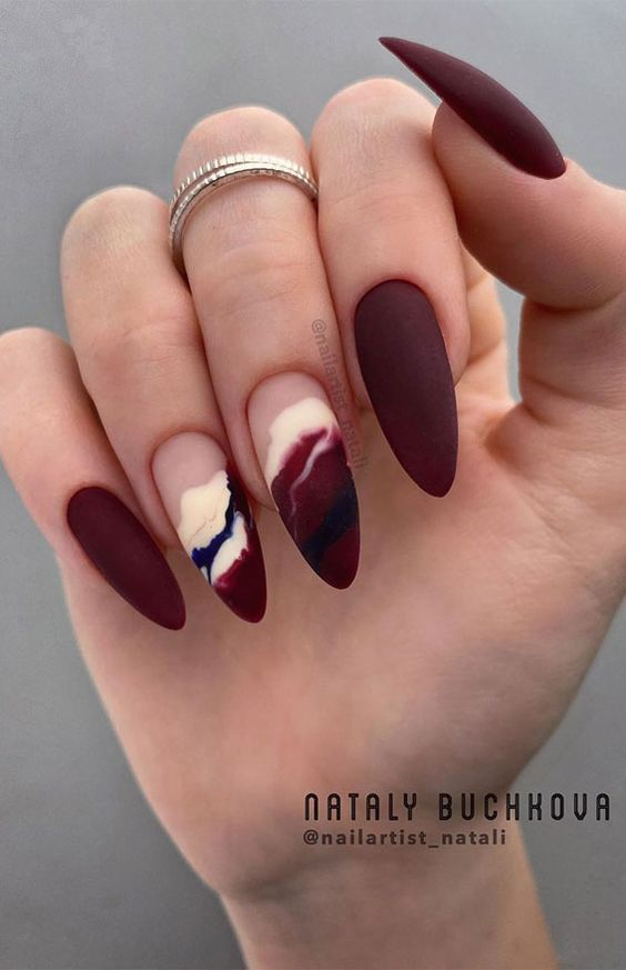 burgundy nails with marble wave design