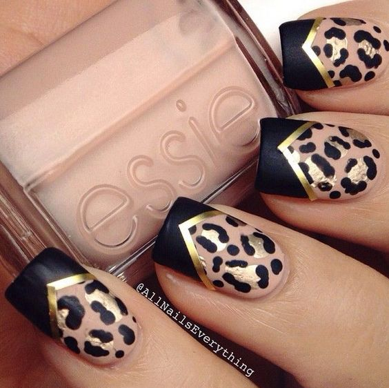 Black leopard nails with gold accents