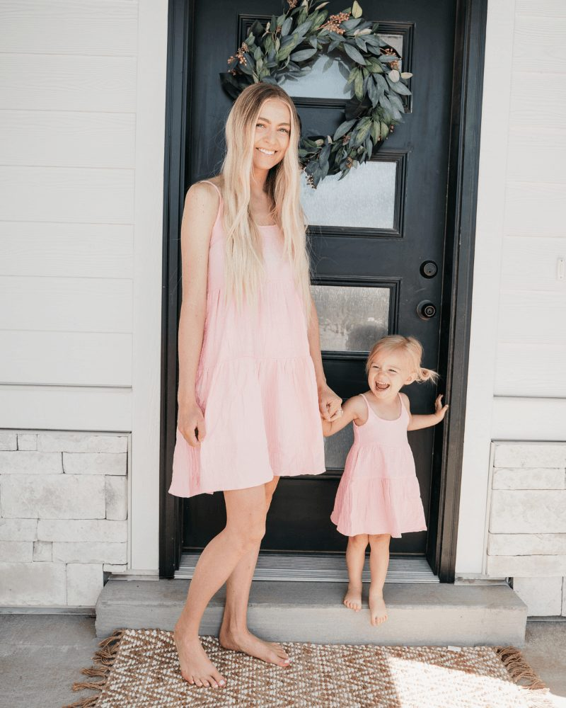 Matching light pink sundresses for mom and toddler daughter