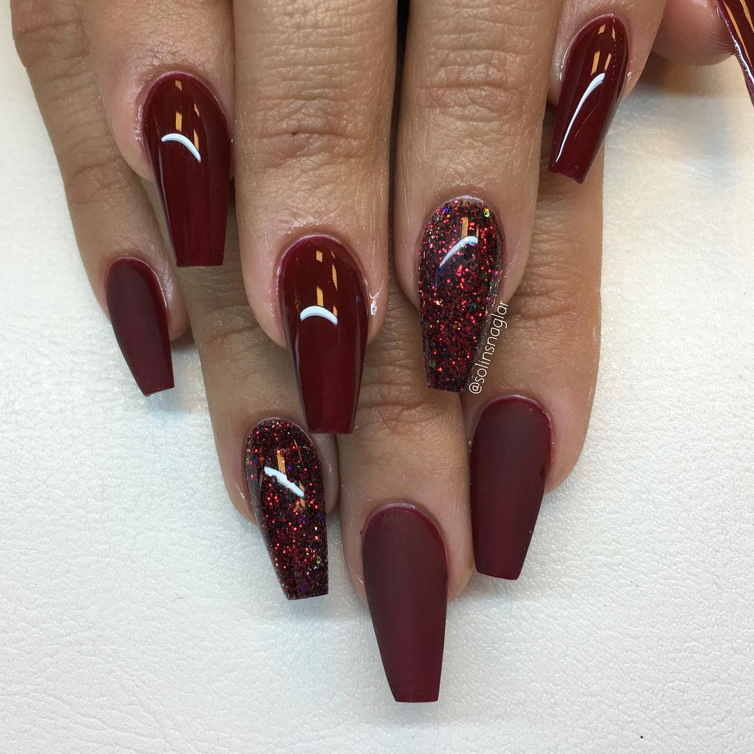 Burgundy red gel nails with glitter
