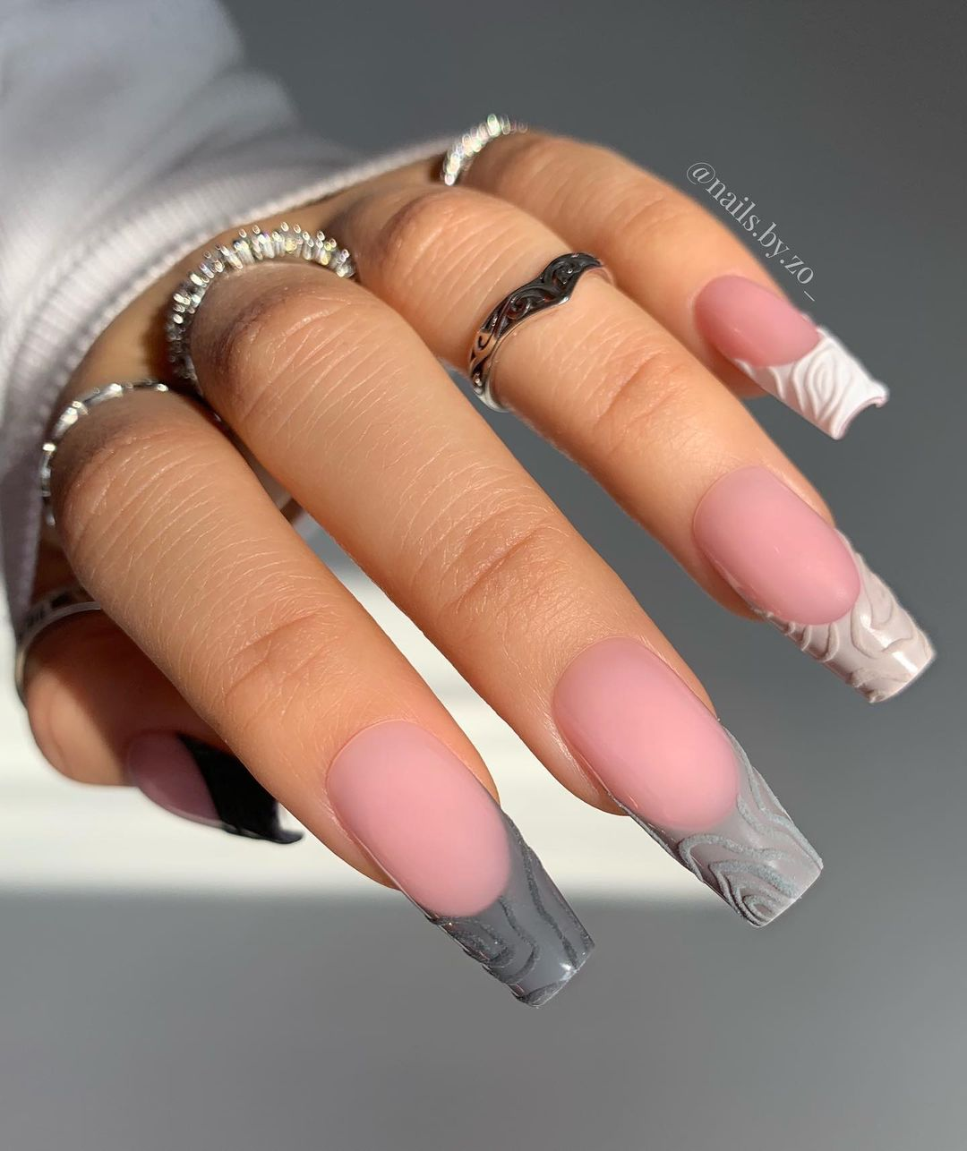 Gradient grey french tip nails with embossed design