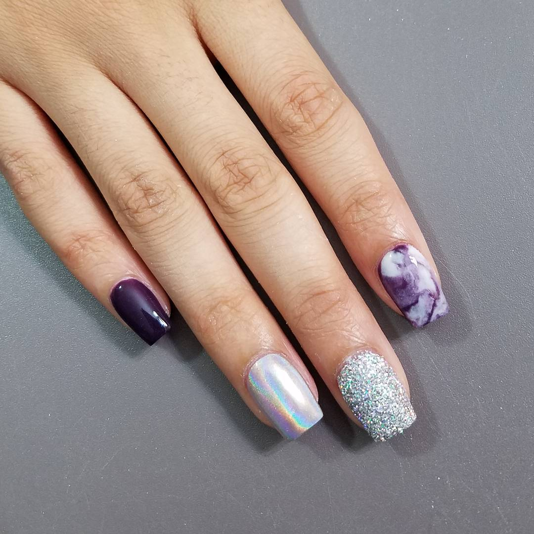 Violet gel nails with holographic and glitter details